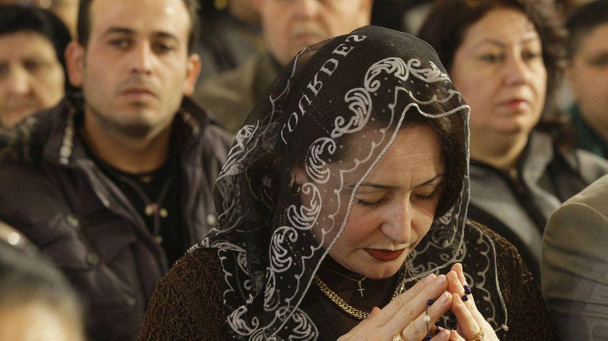 Iraqi Christians attend a Christmas mass at St. Joseph's Chaldean church in Baghdad, Iraq, Sunday, Dec. 25, 2011.