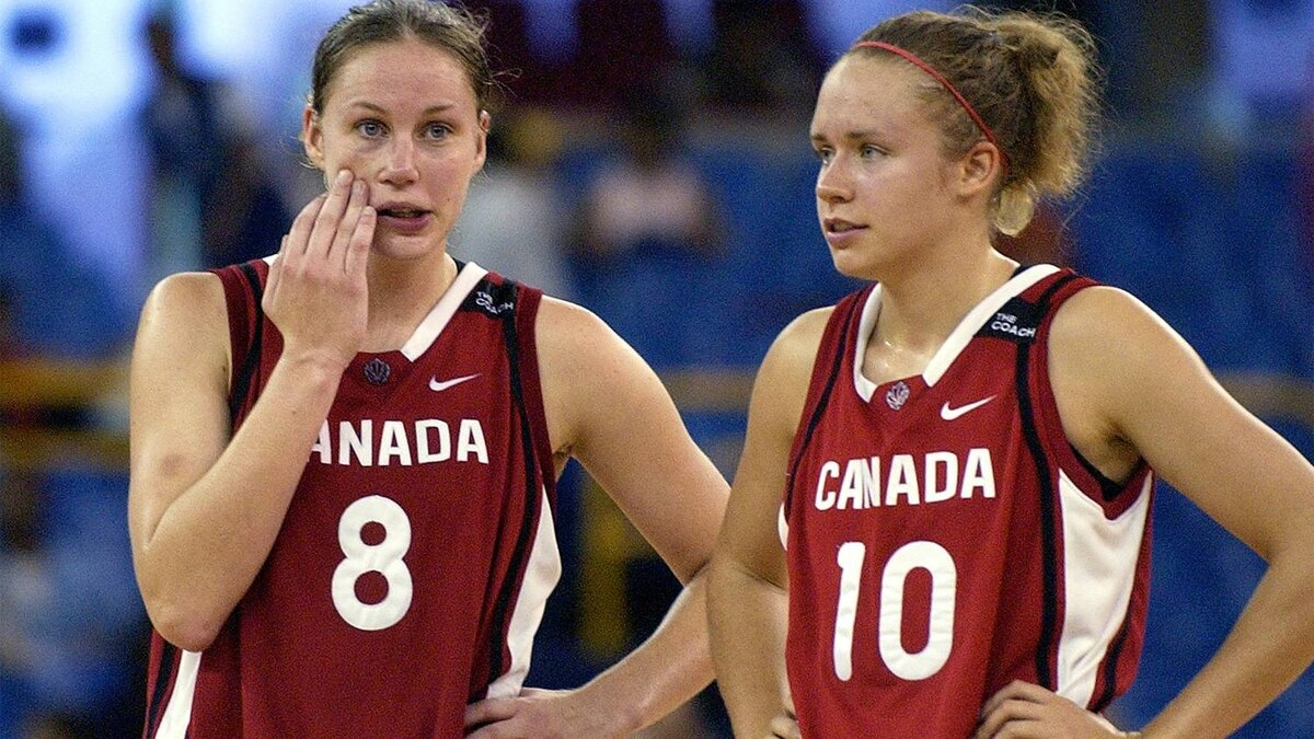 Canada's Kim Smith, left, and Shona Thornburn talk with seconds left in their game against Brazil in women's basketball at the 2003 Pan American Games, Saturday, Aug. 9, 2003, in Santo Domingo, Dominican Republic.