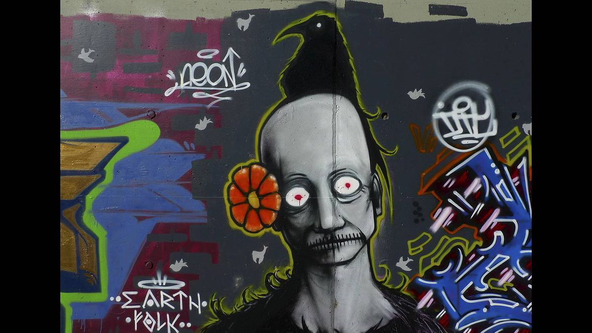 Lee Gunderson photo: Graffiti under a railway brdige in Calgary. Almost deserving of having a place in the national museum of art. Portrays man as sinner/saint and deeply spiritual and born of the earth.