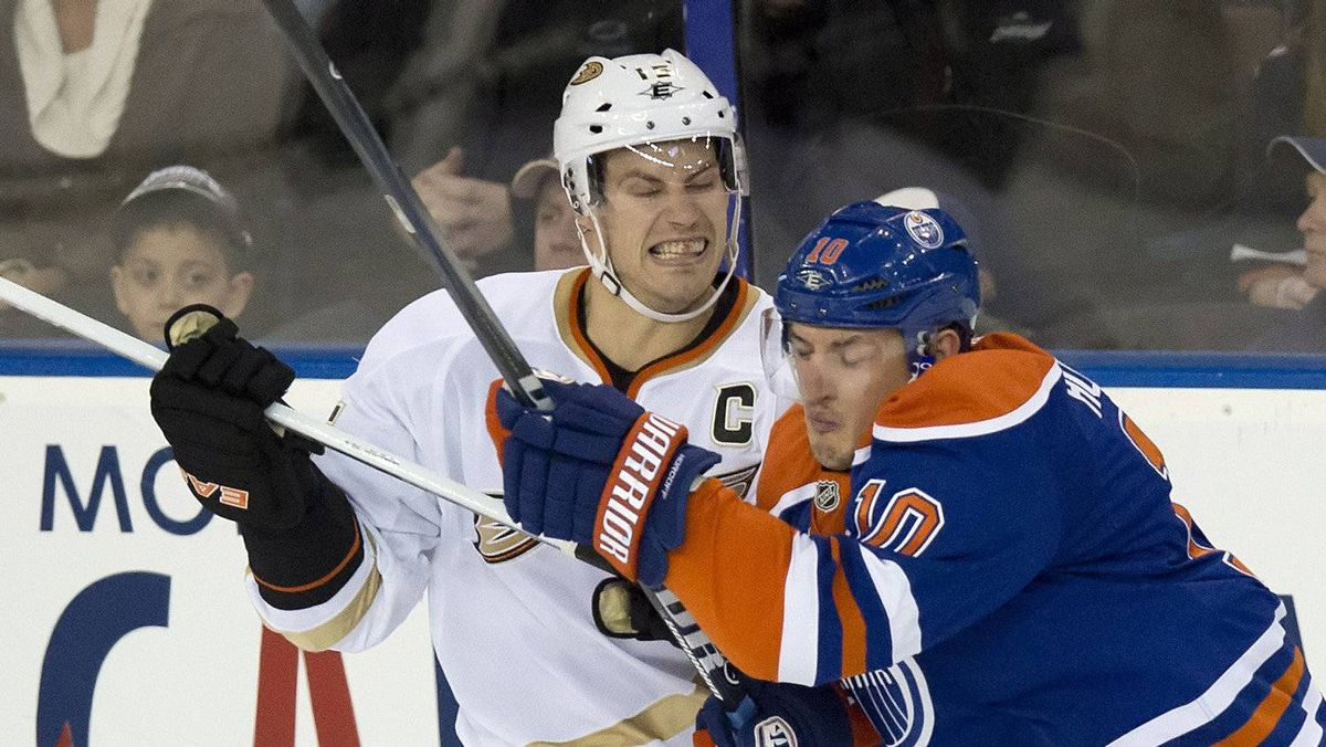 Anaheim Ducks' Ryan Getzlaf, left, collides with the Edmonton Oilers' Shawn Horcoff during the first period of the NHL hockey game in Edmonton on Thursday, April 5, 2012.
