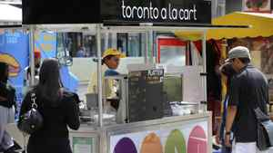The Toronto a la Cart food stand located at Nathan Phillips Square in 2009. It was part of Toronto's failed pilot program to provide a wider variety of food cart options.