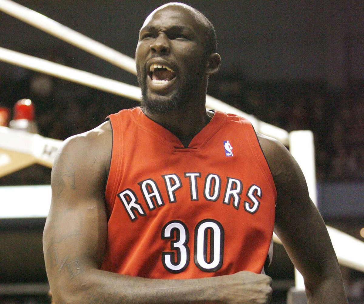 Caption: Toronto Raptors forward Reggie Evans reacts after a basket against the Philadelphia 76ers during the first half of their pre-season NBA basketball game in London, Ontario October 6, 2009. REUTERS/ Mike Cassese