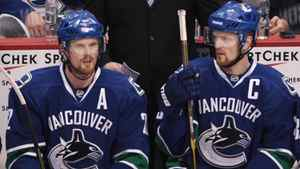 Daniel Sedin, left, and his twin brother Henrik Sedin, both of Sweden, sit on the bench during the third period of game 5 of an NHL Western Conference quarterfinal Stanley Cup playoff hockey series in Vancouver, B.C., on Thursday April 21, 2011.