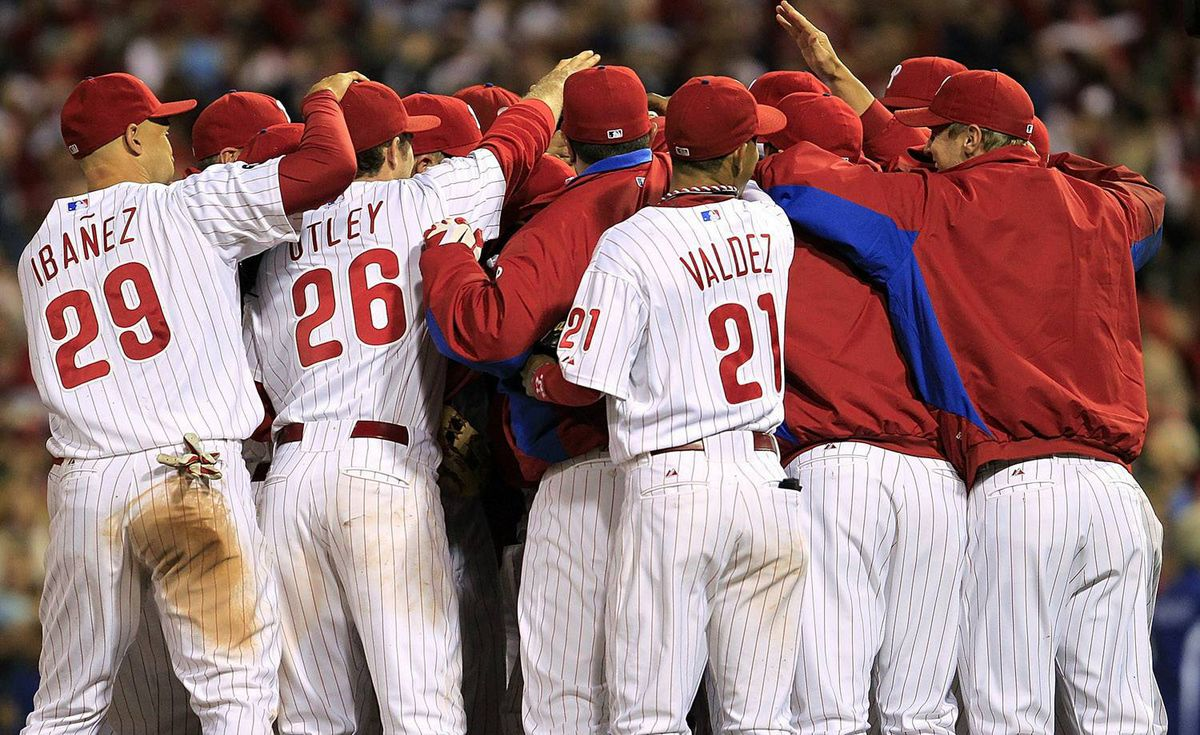 Roy Halladay #34 of the Philadelphia Phillies is mobbed by teammates after pitching a no-hitter and the win in Game 1 of the NLDS against the Cincinnati Reds at Citizens Bank Park on October 6, 2010 in Philadelphia, Pennsylvania. (Photo by Chris Trotman/Getty Images)