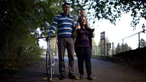 Ross Arbo along with his son Kale, age 3, and wife, Jen, pose for a portrait along his bike route in New Westminster, British Columbia, Tuesday, October 18, 2011. Rafal Gerszak for the Globe and Mail