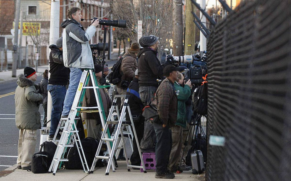 Members of the media set up for the funeral service of pop singer Whitney Houston at the New Hope Baptist Church in Newark, New Jersey February 18, 2012.
