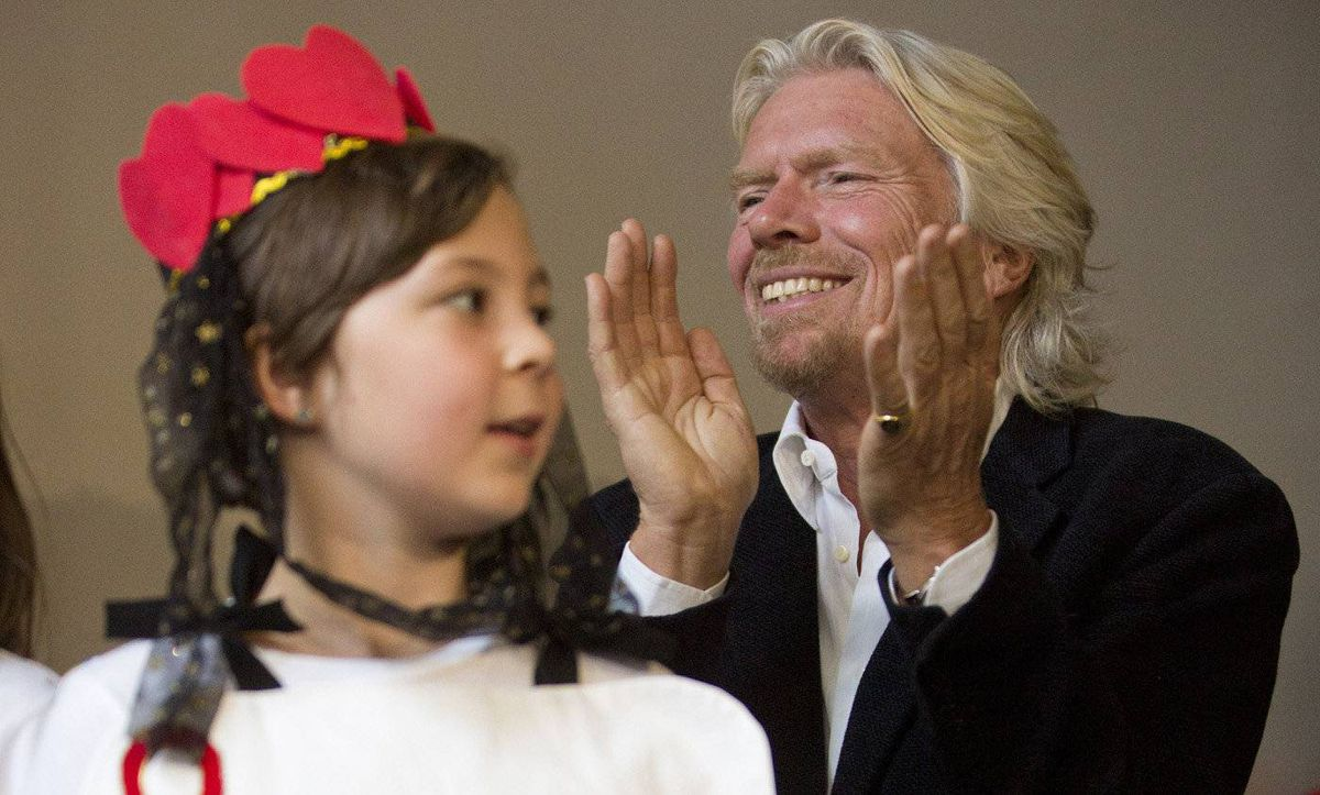 Sir Richard Branson claps during a press conference in Vancouver after children from Project Limelight sang for Branson and Canadian actor Cory Monteith in Vancouver May 25, 2012.
