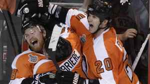 Philadelphia Flyers right wing Claude Giroux, left, celebrates with Danny Briere, center, and Chris Pronger, right, after Giroux scored the game-winning goal against the Chicago Blackhawks in overtime of Game 3 of the NHL Stanley Cup hockey finals Wednesday, June 2, 2010, in Philadelphia. The Flyers won 4-3. The Blackhawks lead the series 2-1.