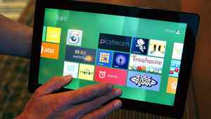 A Reuters reporter runs through a new test Microsoft Windows tablet running a version of its touch-enabled Windows 8, expected to be released in 2012, at the Build conference in Anaheim, California September 13, 2011.