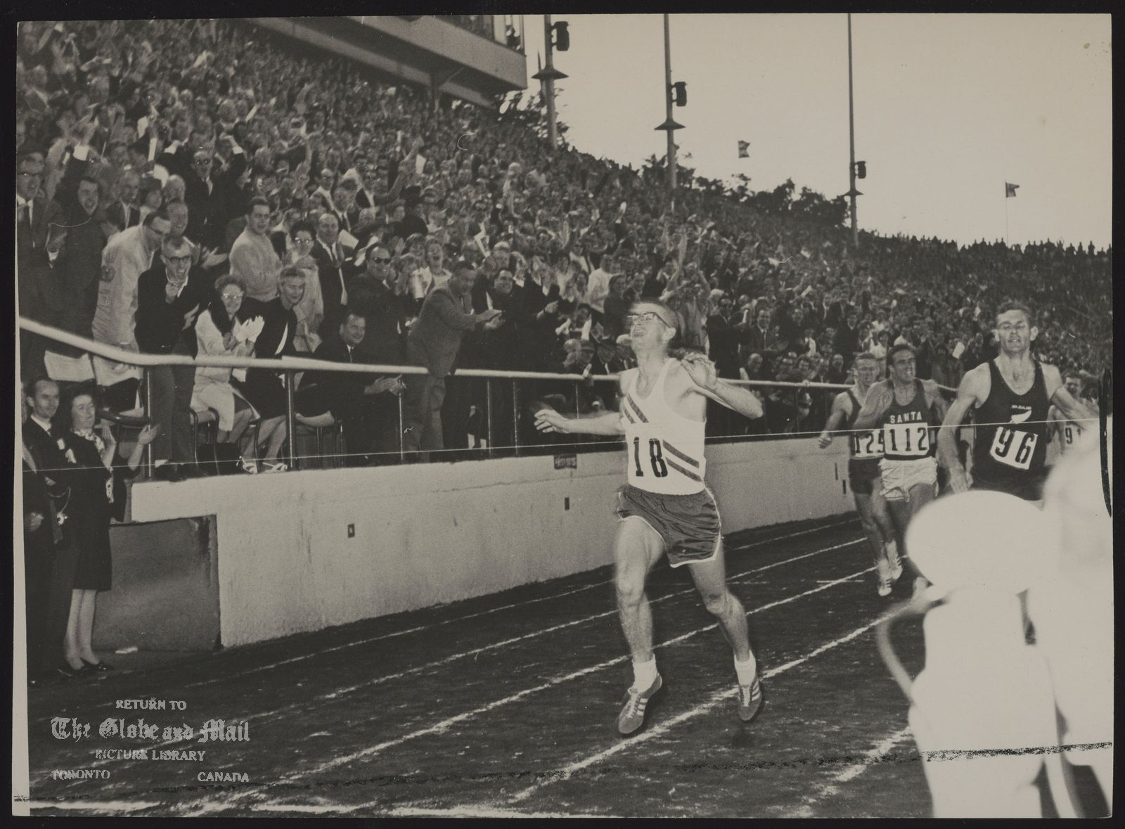 Bill CROTHERS Part of the crowd of 19,633 at Varsity Stadium roars at exciting finished as Bill Crothers beats Peter Shell (96) in 880-yard race last night.