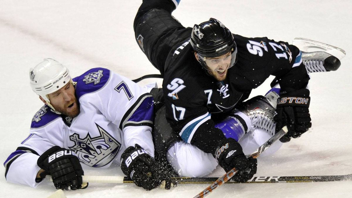 Los Angeles Kings defenseman Rob Scuderi (L) takes down San Jose Sharks center Torrey Mitchell in the first period during Game 5 of the NHL Western Conference quarter-final hockey playoff in San Jose, California April 23, 2011. REUTERS/Chad Ziemendorf