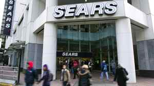 People walk past the main Sears store in downtown Vancouver.