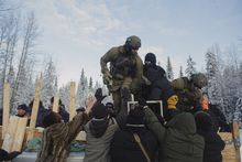 The Royal Canadian Mounted Police clear a barricade set up by a First Nations group at the Gitdumden checkpoint near Houston, British Columbia, Canada, Jan. 7, 2019. On one side of the barricade in remote British Columbia, members of the Wet'suwet'en people hoped to stop a pipeline that would cross their traditional land. On the other side were heavily armed police. (Amber Bracken/The New York Times)