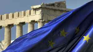 Columns of the Parthenon are seen behind an European Union flag in Athens on Nov. 4, 2011.