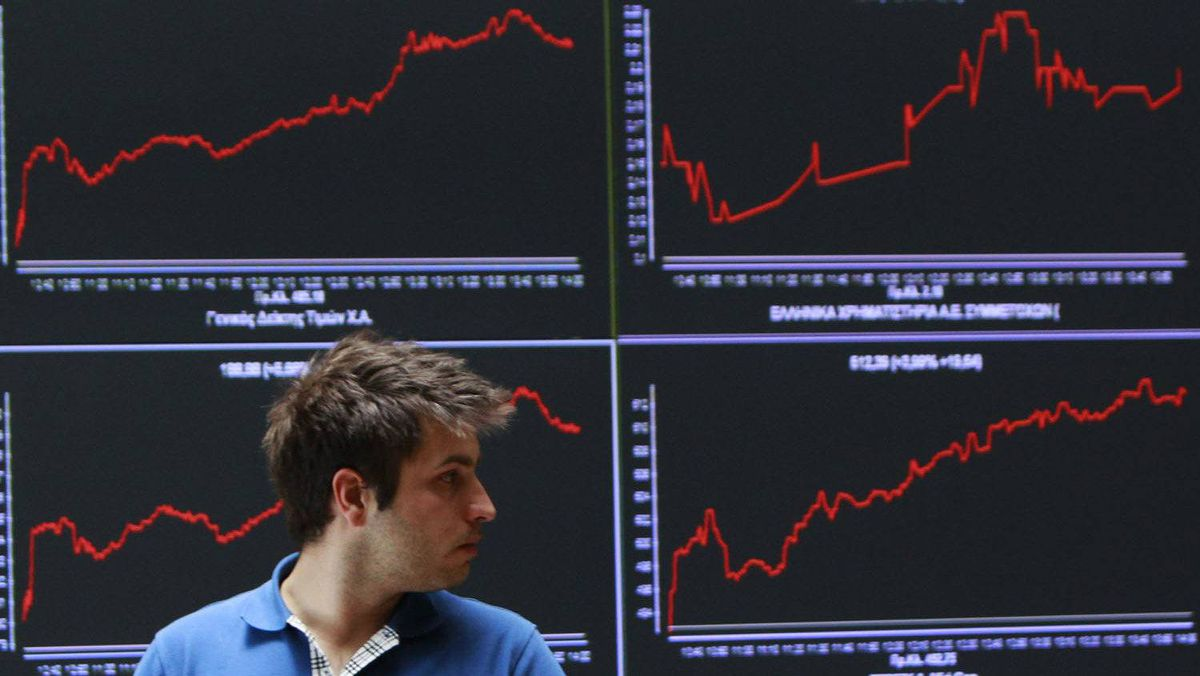 A man walks in front of an index board at the reception hall of the Athens Stock exchange May 28, 2012.