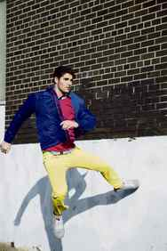 Bold colours and sexy silhouettes herald a mini-renaissance in fashion for guys. Breakout model/actor Nick Bateman shows off the breakthrough looks Paul Smith Jeans windbreaker, $295, Prada shirt, $730 at Holt Renfrew. John Smedley sweater, $198 at Harry Rosen. Zegna Sport jeans, $225 through www.zzegna.com. Penguin sneakers, $118 at Town Shoes (www.townshoes.com).