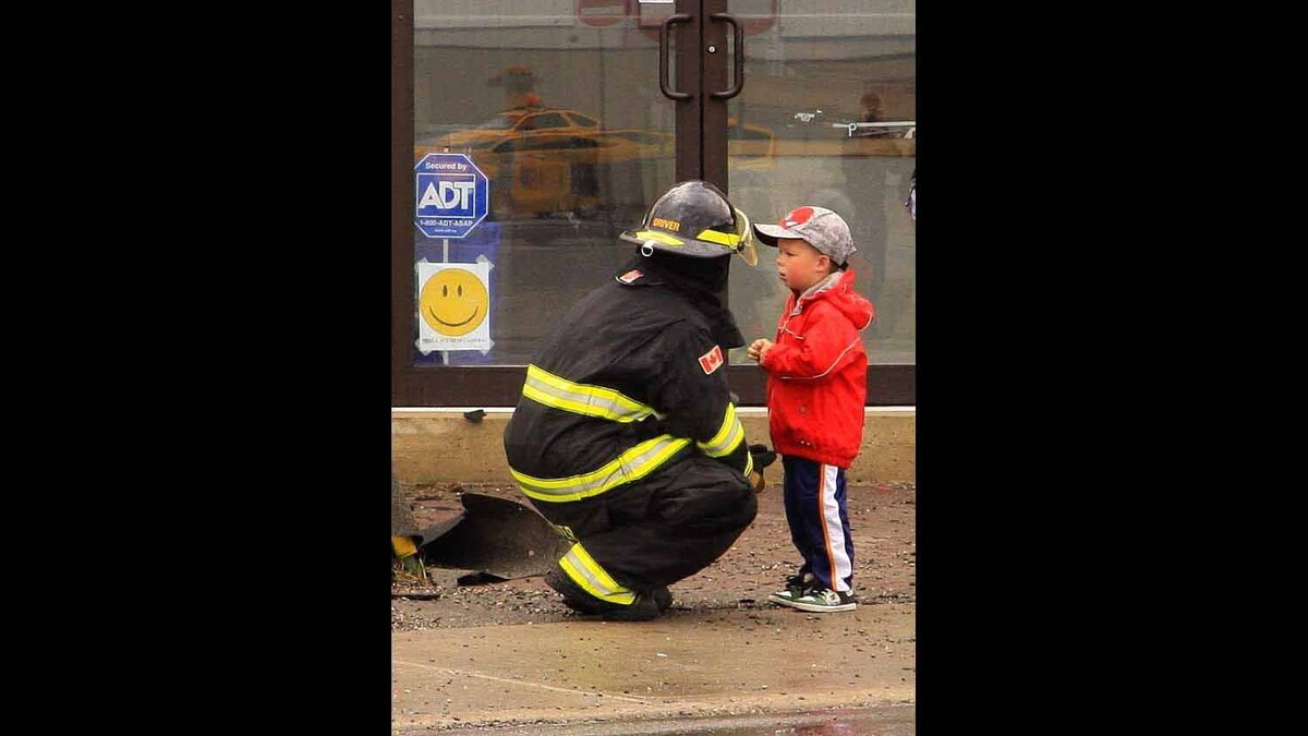 Fireman explaining to young boy about the fire