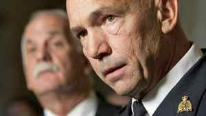 Public Safety Vic Toews looks on as newly appointed RCMP Commissioner Bob Paulson takes question from reporters in the foyer of the House of Commons on Nov. 16, 2011.