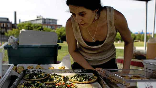 Vegan pizzas at the West End Food Co-op's Sorauren Farmers' Market are made entirely from market ingredients.