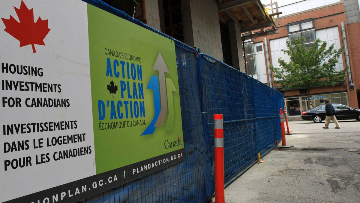 A government Economic Action Plan sign adorns a social housing project under construction in Vancouver on May 24, 2010.