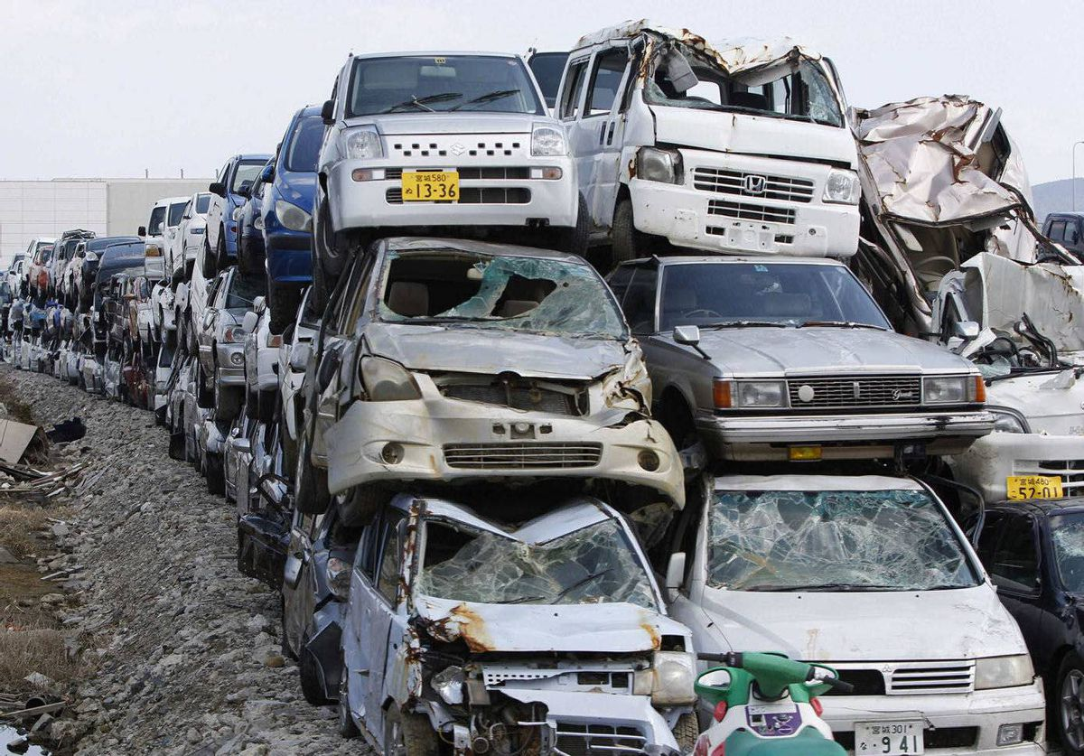 Vehicles destroyed by the March 11, 2011 earthquake and tsunami are seen piled up in Ishinomaki, Miyagi prefecture, Japan.