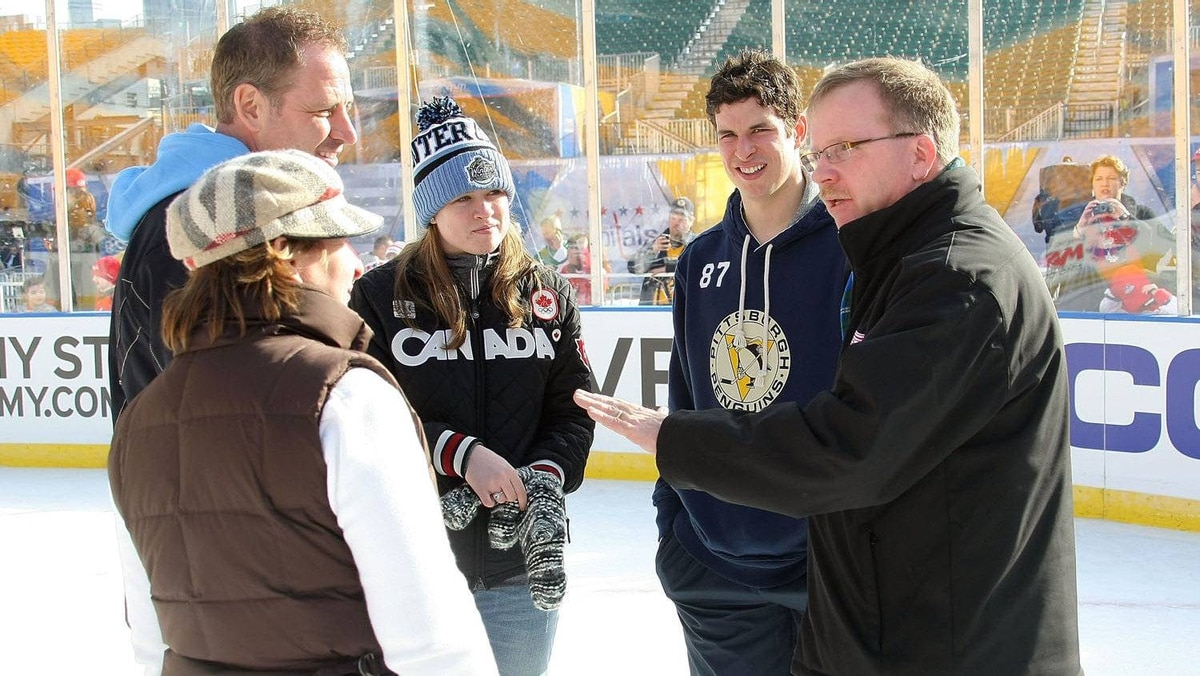 Sidney Crosby #87 of the Pittsburgh Penguinstalks with with his father Troy(L) , mother Trina, sister Taylor and his former Coal Harbor coach Paul Mason during a family skate following practice for the 2011 NHL Bridgestone Winter Classic at Heinz Field on December 31, 2010 in Pittsburgh, Pennsylvania. (Photo by Dave Sandford/NHLI via Getty Images)