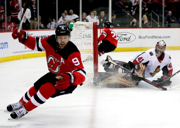 6df32bcd Ottawa Senators goaltender Craig Anderson watches as New Jersey Devils left  wing Taylor Hall celebrates after scoring a goal during a game in Newark,  N.J.