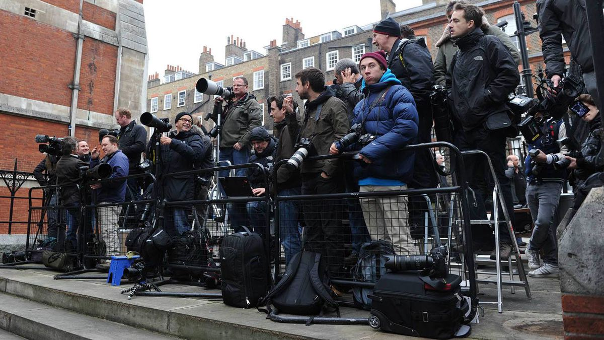 Members of the media stand outside the Leveson Inquiry at the High Court in London Nov. 21, 2011.