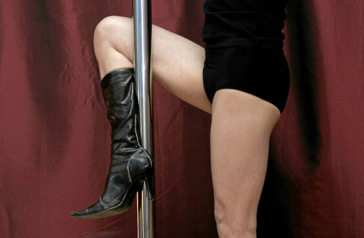 A pole-dancing instructor in Beijing. Some experts are concerned that risqu� classes play to body image, not overall wellness.