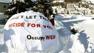David Roth helps to build the first igloo of the Occupy WEF movement at their campsite in Davos, Swweitzerland.