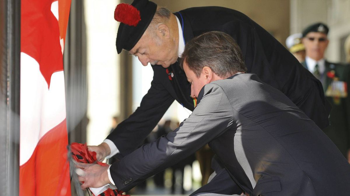 Britain's Prime Minister David Cameron and a British veteran pay tribute at a monument with the names of British soldiers during the Remembrance Day ceremony at the War Memorial Gloster Valley, at Solma-ri north of Seoul on Nov. 11, 2010 before the start of the G20 Summit.