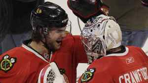 Chicago Blackhawks goalie Corey Crawford, right, celebrates with Michael Frolik after they defeated the Vancouver Canucks 4-3 in Game 6 of an NHL hockey Stanley Cup playoffs first-round series Sunday, April 24, 2011, in Chicago. (AP Photo/Nam Y. Huh)