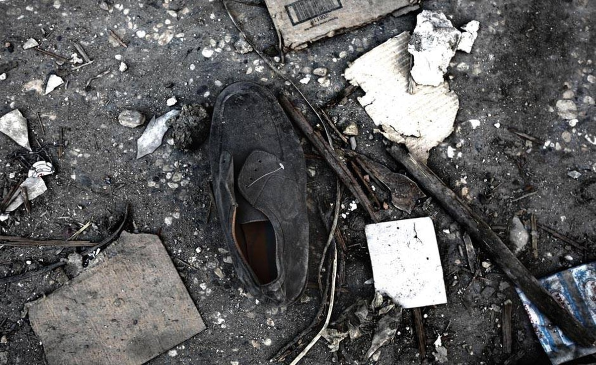 A man's shoe is seen in the debris of Port-au-Prince's commercial district.