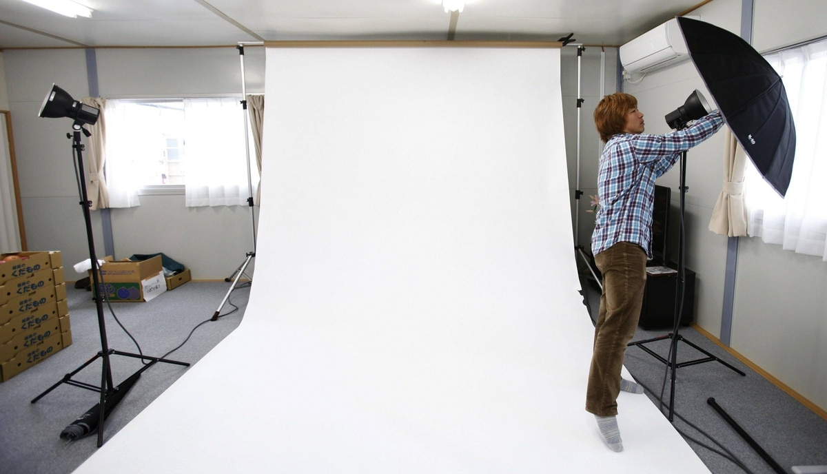 Photographer Kenichi Funada sets up a makeshift studio to take pictures of residents as part of the 3.11 Portrait Project. The project was conceived by photographer Nobuyuki Kobayashi who takes portraits of Japan's earthquake survivors. The portraits are then sent to schoolchildren from non-disaster areas, who frame the portraits and send them back to the survivors along with personal messages of support.