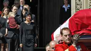 With his widow, Toronto MP Olivia Chow, and children looking on, Jack Layton's casket is carried out of Centre Block on Aug. 25, 2011. The late Opposition Leader had been lying in state for two days on Parliament Hill.