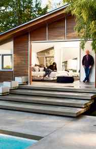 The concrete platform stairs leading to the space are, says Ross, 'the same width as the folding doors and the pool, creating visual continuity through a single seamless line.'