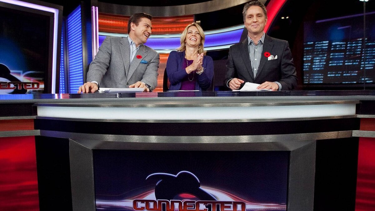 Hockey analyst Nick Kypreos, anchor Martine Gaillard and anchor Brad Fay are seen in Sportsnet's studio in Toronto on November 9, 2010.