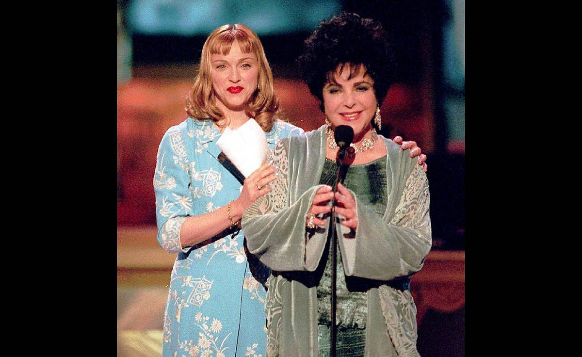 Elizabeth Taylor, right, is joined onstage at the Pantages Theater by Madonna in Hollywood Sunday, Feb. 16, 1997, during a birthday celebration for Taylor who turned 65 that month.