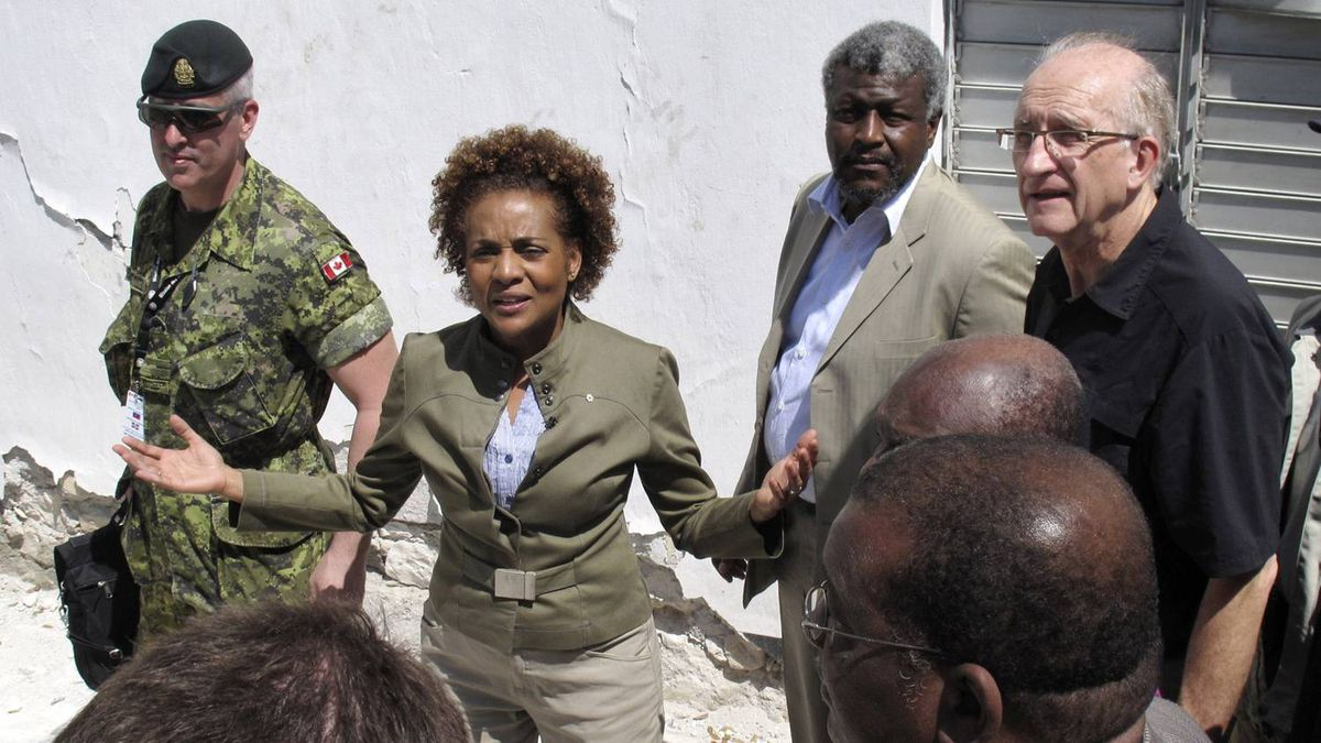 Canada Governor-General Michaelle Jean speaks with the residents and members of her delegation in Port-au-Prince March 8, 2010.