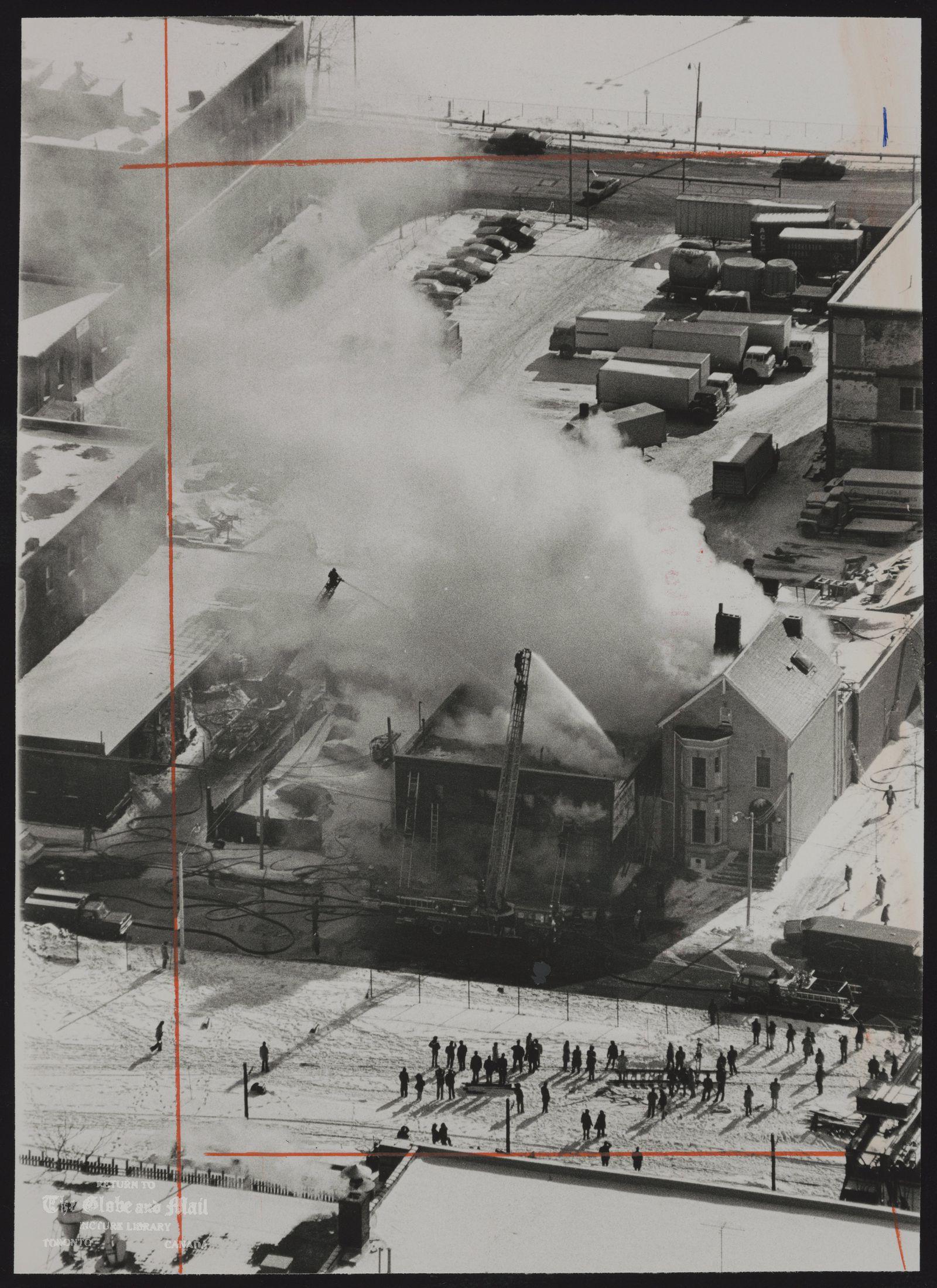 TORONTO ARTS PRODUCTION Firemen pour water on the Toronto Arts Productions Building, which was gutted.