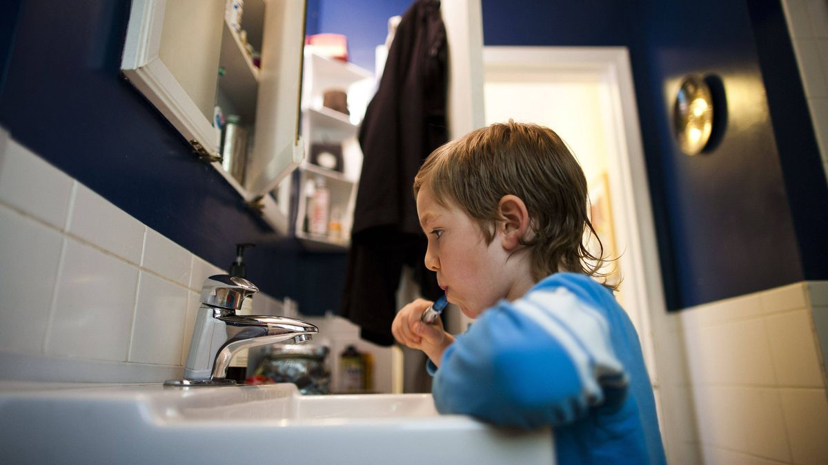 Five-year-old An'ostin Todd brushes his teeth before lunch at his home in New Westminster, B.C.
