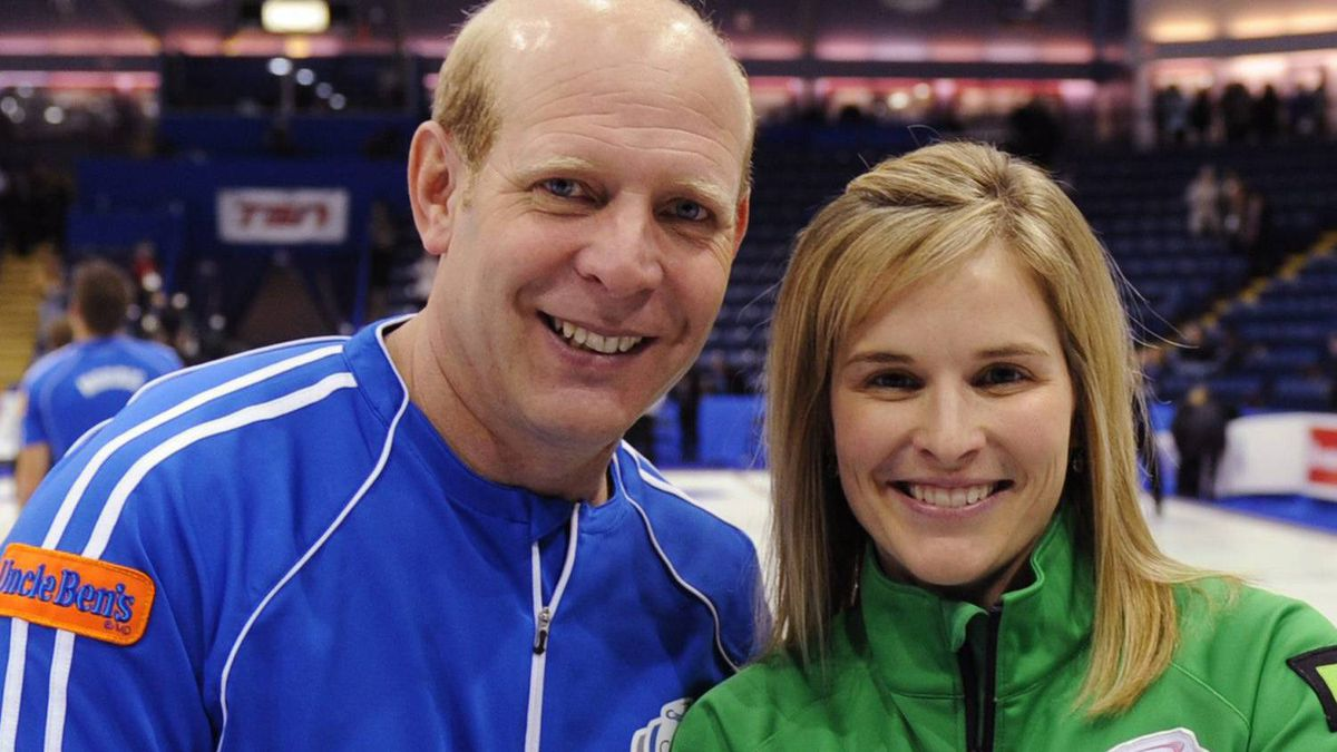 Winning skips Kevin Martin of Edmonton and Jennifer Jones of Winnipgeg hold the Capital One Canada Cup trophy after guiding their teams to the championships at Capital One Canada Cup Curling in Cranbrook, B.C. on Sunday, Dec. 42011. THE CANADIAN PRESS/ho-Michael Burns