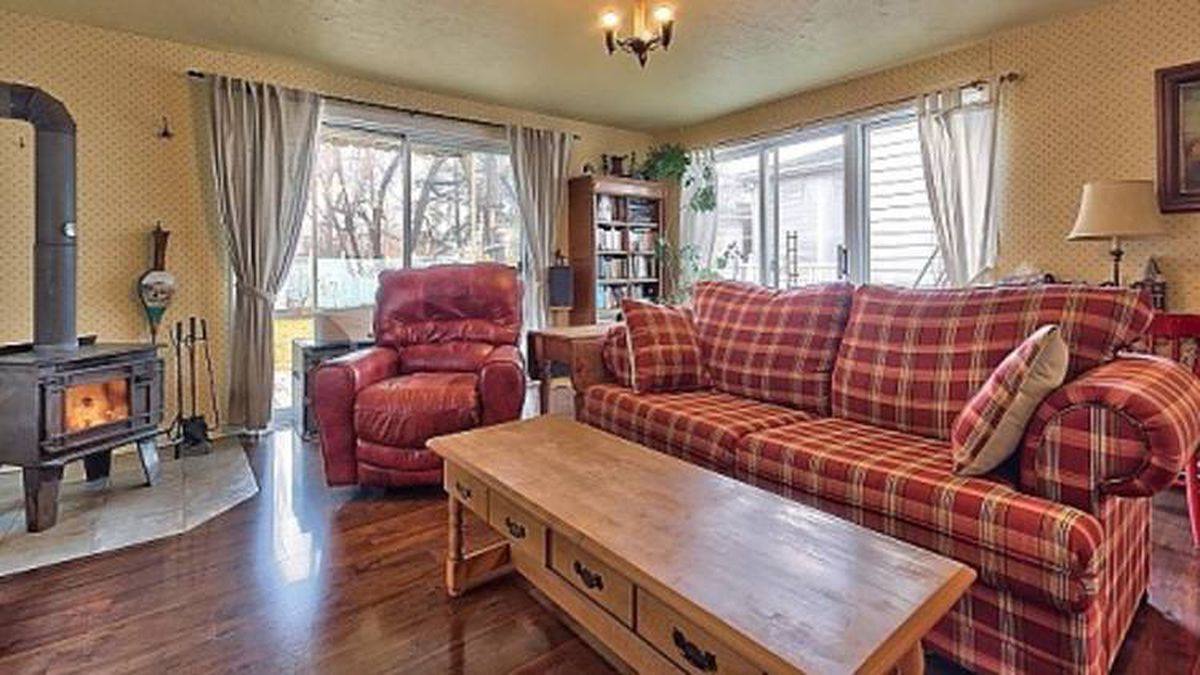 The main floor has a large family room with new hardwood flooring and a wood stove.
