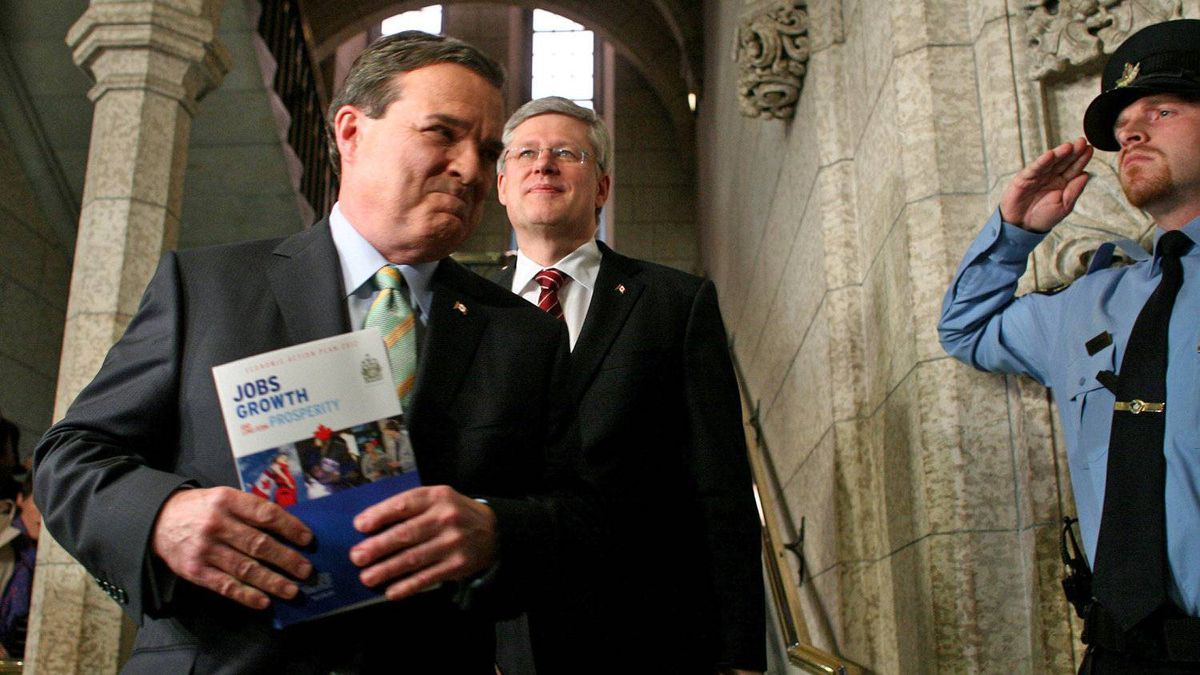 Prime Minister Stephen Harper and Finance Minister Jim Flaherty enter the House of Commons to deliver the federal budget on March 29, 2012.