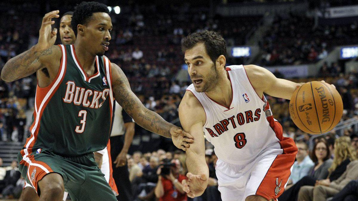 Toronto Raptors guard Jose Calderon goes to the basket against Milwaukee Bucks guard Brandon Jennings (L) during the first half of their NBA basketball game in Toronto February 8, 2012.