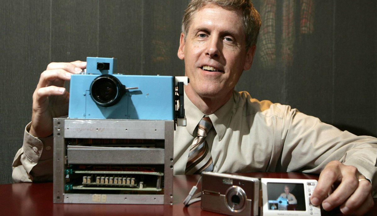 Steven J. Sasson, Eastman Kodak Co. project manager, shows his prototype digital camera he built in 1975 next to Kodak's latest digital camera the EasyShare One, at Kodak headquarters in Rochester, N.Y., Wednesday, Aug. 17, 2005.