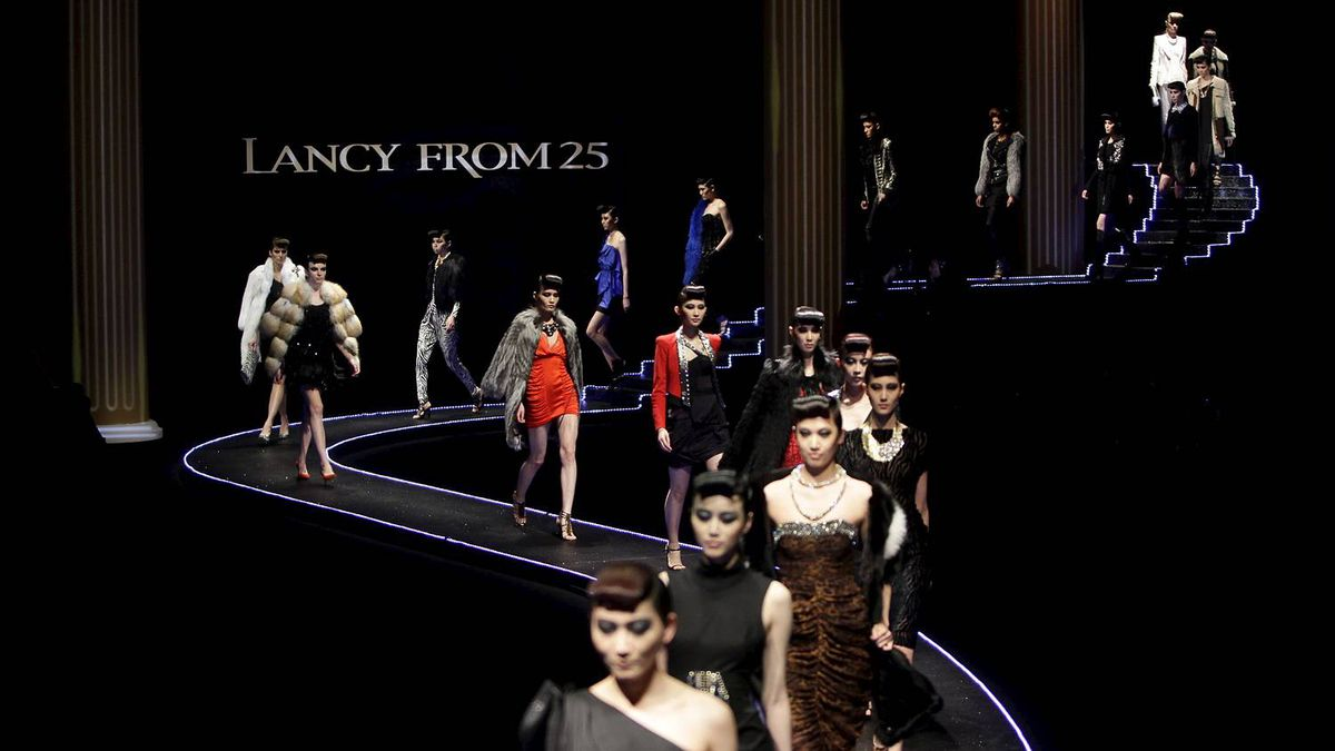 Models present creations for the LANCY 2011/2012 Autumn and Winter collection during China Fashion Week in Beijing March 24.