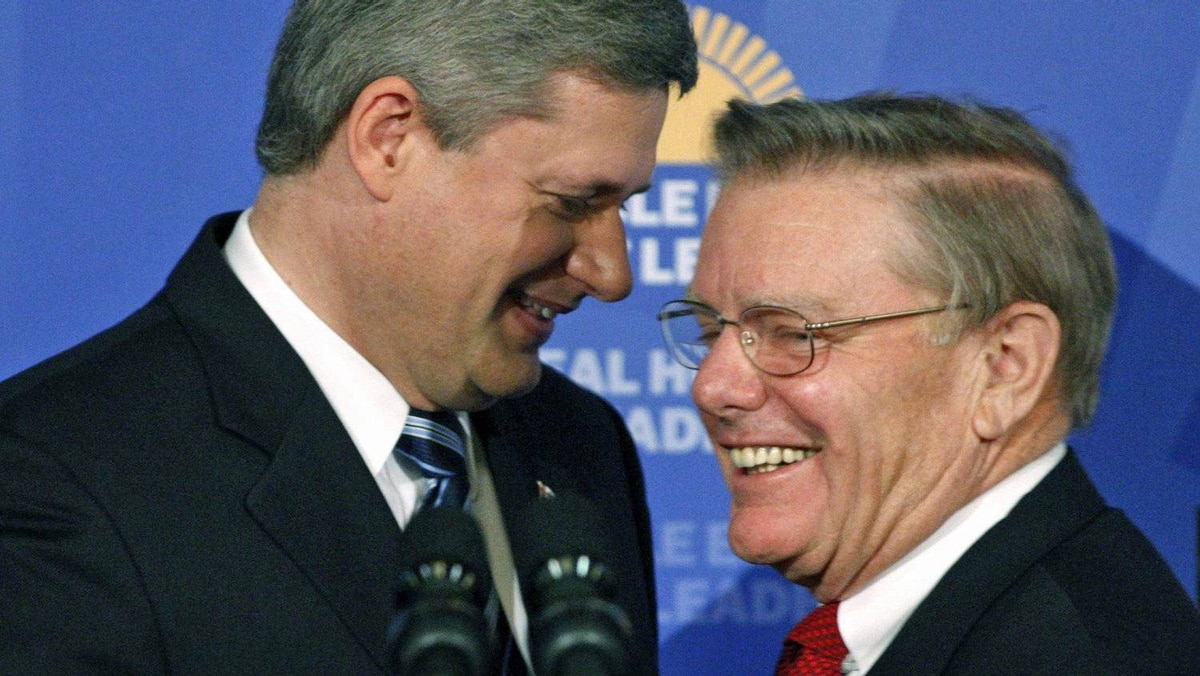 Prime Minister Stephen Harper shares a laugh with Canadian Mental Health Commission chairman Michael Kirby after an Ottawa news conference on Aug. 31, 2007.