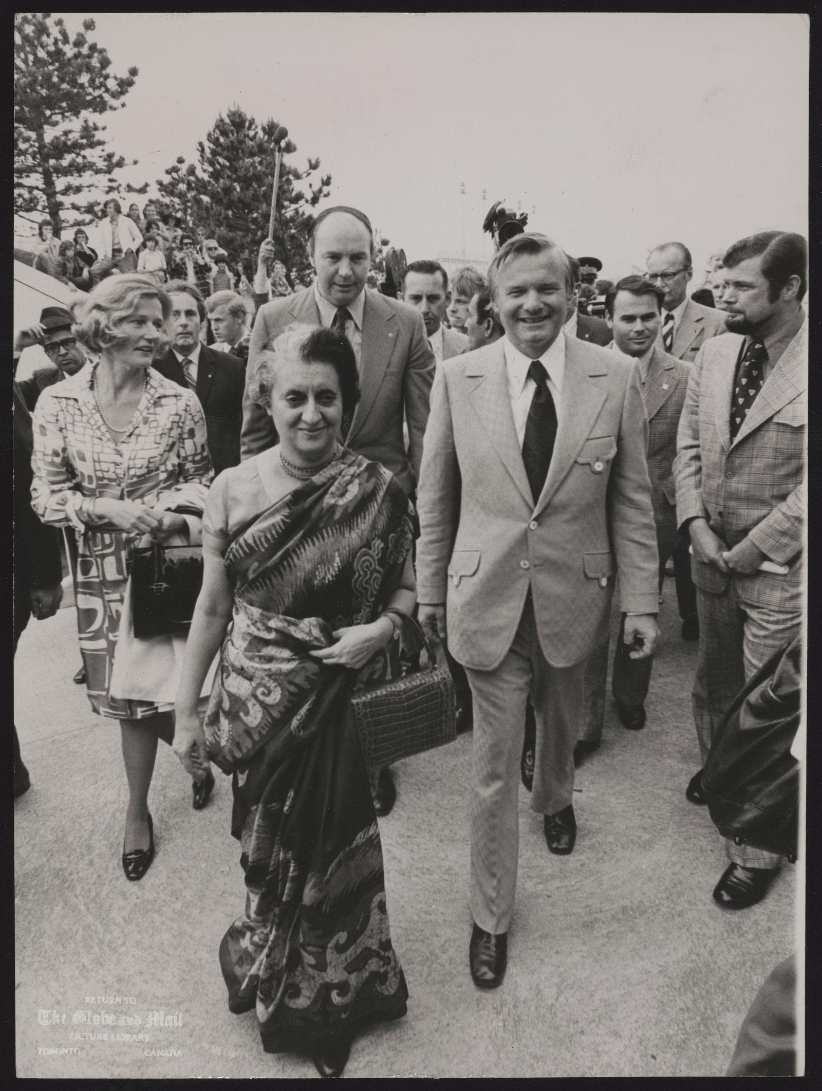 Indira GANDHI Indira Gandhi followed by Premier William Davis, visits Ontario Place