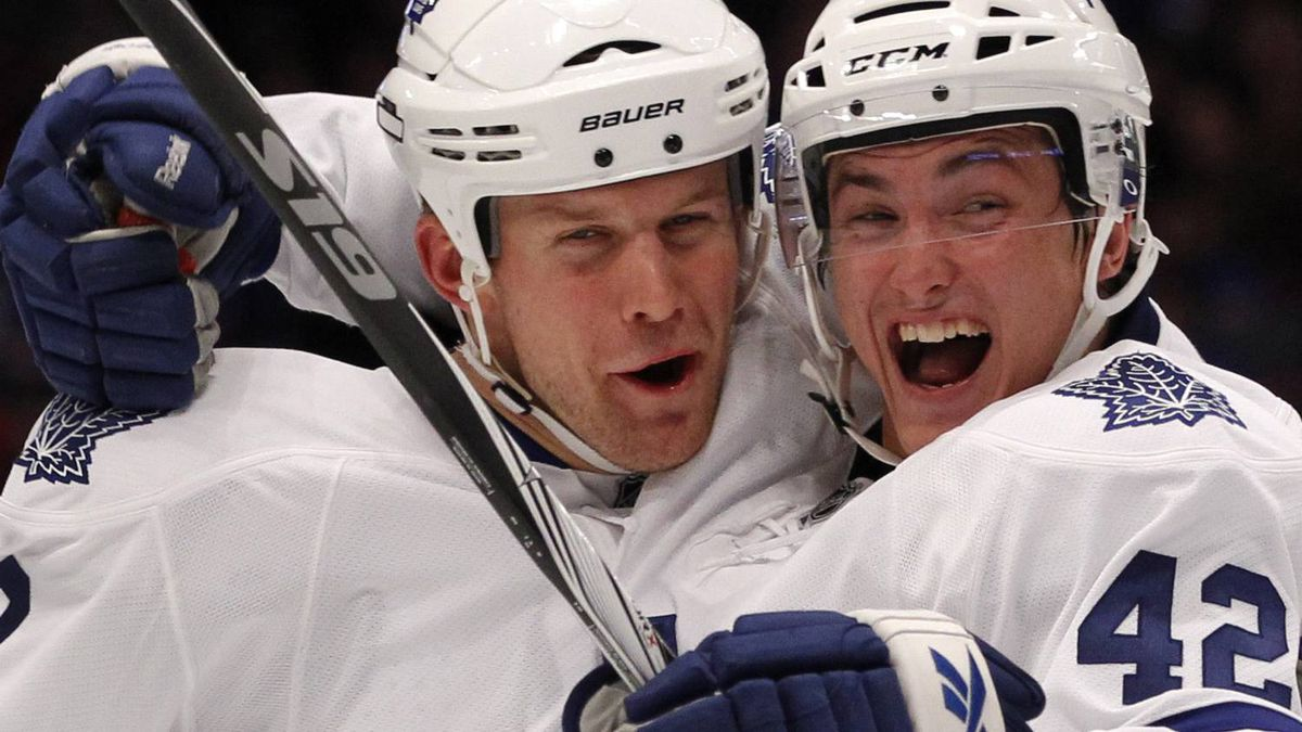 Toronto Maple Leafs' Mike Komisarek (L) celebrates with his teammate Tyler Bozak after Komisarek's goal against the New York Rangers in the second period of their NHL hockey game in New York October 15, 2010. REUTERS/Mike Segar
